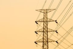Silhouette of high voltage electrical pole structure.  Stock Images