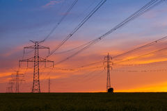 Silhouette of high voltage electrical pole structure Stock Photography