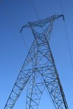 Silhouette of a high voltage electricity pylon. Against the deep blue sky royalty free stock photos
