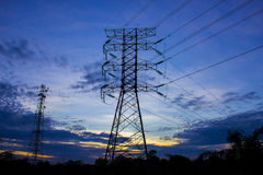 Silhouette of high voltage electricity tower Royalty Free Stock Photos