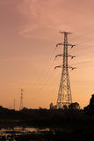 Silhouette of high voltage post Stock Images