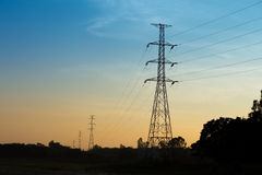 Silhouette of high voltage post Royalty Free Stock Images