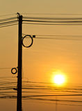 Silhouette of high voltage power lines royalty free stock images