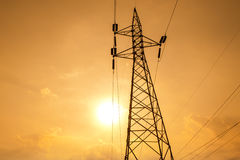 Silhouette of high voltage power lines Stock Photography