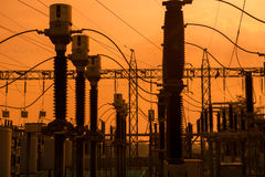 Silhouette of high voltage power plant and transformation statio Stock Photos