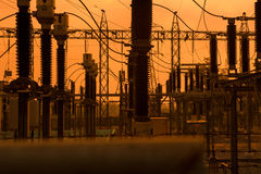 Silhouette of high voltage power plant and transformation statio Royalty Free Stock Photos