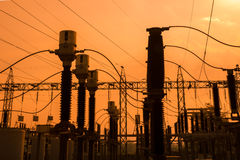 Silhouette of high voltage power plant and transformation statio Stock Image