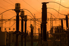 Silhouette of high voltage power plant and transformation statio Royalty Free Stock Images