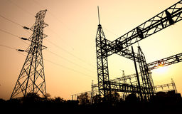 The silhouette of high voltage substation Stock Images