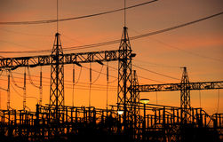 Silhouette high voltage supply power pole in evening time Stock Photography