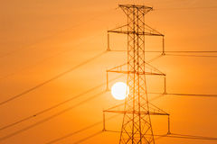 Silhouette of High voltage tower. Stock Photography