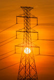 Silhouette of High voltage tower. Stock Images