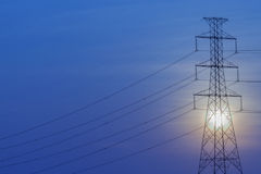 Silhouette of High voltage tower. Royalty Free Stock Photos