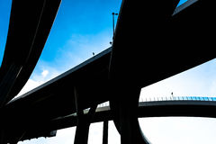 Silhouette of highway ramps on a sunny day Stock Image