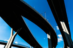 Silhouette of highway ramps on a sunny day Royalty Free Stock Images