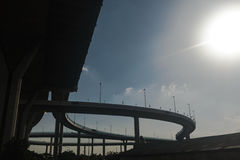 Silhouette of highway ramps on a sunny day Stock Images