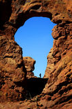 Arch in Canyon Rock Formations Silhouetter of Hiker Royalty Free Stock Images