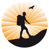 Silhouette of hiker and bird Royalty Free Stock Image