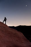 Silhouette of hiker with moon. In the desert Royalty Free Stock Photography