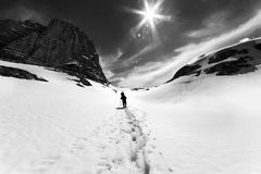 Silhouette of hiker in snowy mountains royalty free stock photos