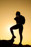 Silhouette of the hiker  on sunset Royalty Free Stock Photography