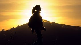 Silhouette of hiker tourist woman with backpack trekking on mountain at sunset. Hiker girl, Female traveler woman. Silhouette of hiker tourist woman with stock video