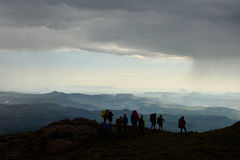 Silhouette of hikers looking at mountains and valleys Royalty Free Stock Photography