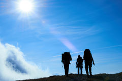 Silhouette of hiking friends Stock Image