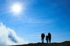 Silhouette of hiking friends Royalty Free Stock Image
