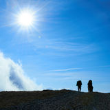 Silhouette of hiking friends Stock Photos