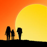 Silhouette of hiking friends Stock Images