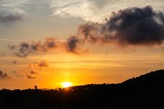 Silhouette of hill at summer sunset. royalty free stock photography