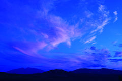 Silhouette of hills with blue sky Stock Image