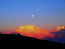 Silhouette of Hills Under Orange and Blue Cloudy Sky Royalty Free Stock Image