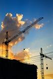 Silhouette hoisting crane stock photo