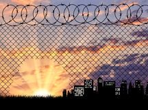 Silhouette  a hole in the fence Stock Photography