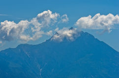 Silhouette of the holy mountains Athos and a small cloud above the mountain top, Chalkidiki royalty free stock photos