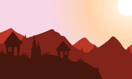 Silhouette of home on the mountain Stock Images