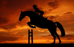 Silhouette of horse. Silhouette of a rider on a jumping horse Stock Photos