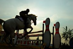 Silhouette of a horse. A show jump horse trying to overcome hurdles at Premiercup Equestrian event in Putrajaya Malaysia Stock Photos