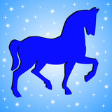 Silhouette of horse on a blue background Stock Photo