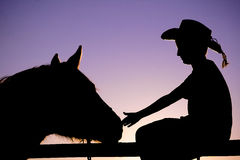 Silhouette of Horse & Cowboy Royalty Free Stock Image