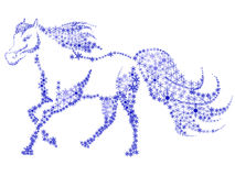 Silhouette of a horse in the snow flakes Stock Photo