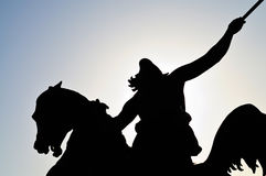 Silhouette of a horseman statue.  Stock Photo