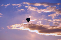 Silhouette of hot air balloon. A silhouette of a lone hot air balloon rising into the early morning sky over Albuquerque, New Mexico Royalty Free Stock Photos