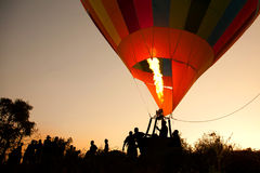 Silhouette hot air balloon landing Royalty Free Stock Image