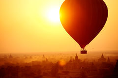 Bagan Balloon. Silhouette of hot air balloon over Bagan in Myanmar, tourists watching sunrise over ancient city Royalty Free Stock Photo