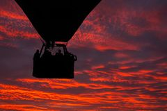 Silhouette of hot air balloon at sunset sky Stock Photography