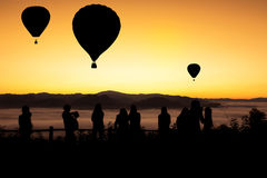 Silhouette hot air balloons floating over yun lai viewpoint, pai, thailand Stock Image