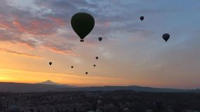 Silhouette of Hot Air Balloons Flying Over Cappadocia at Sunrise